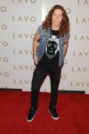 Olympic gold medalist Shaun White celebrates his victory at the Las Vegas Dew Tour at Lavo nightclub.