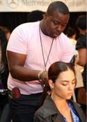 Ted Gibson styling model's hair before Lela Rose Fashion Show