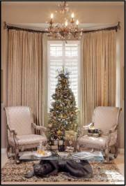For smaller conversation areas, choose neutral themes and be sure to scale down the size of your tree appropriately.