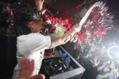 Pauly D sprays champagne at Moon Nightclub.