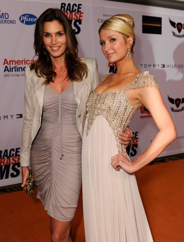 Model Cindy Crawford (L) and Paris Hilton arrive at the 18th Annual Race to Erase MS event co-chaired by Nancy Davis and Tommy Hilfiger at the Hyatt Regency Century Plaza on April 29, 2011 in Century City, California.