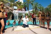 Nathan Burton levitates Miss USA Rima Fakih over the GO Pool at the Flamingo.
