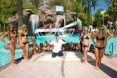 Miss USA Rima Fakih and comedy magician Nathan Burton at the GO Pool at the Flamingo.