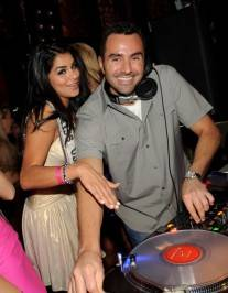 Miss USA Rima Fakih and DJ Jason Lema in the deejay booth at Tao.