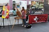 An artist from Emergency Arts performs live painting during the For the Love of Art event.