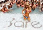 Gretch Rossi flaunts an American flag string bikini at Bare Pool Lounge at the Mirage.