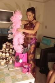 Kim Kardashian snags a boa in her gift bag at Azure Luxury Pool.
