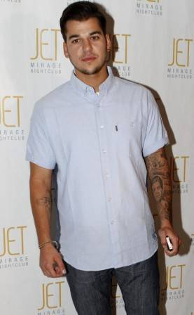 Rob Kardashian walks the red carpet at Jet Nightclub.