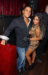 Jionni LaValle and Nicole 'Snooki' Polizzi at LAX Nightclub.