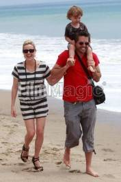 Kathleen Robertson, husband Chris Cowles and son William