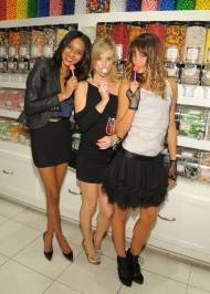 Elizabeth Mathis, Sasha Jackson and Sharni Vinson pose with couture pops inside the Sugar Factory retail store at Paris Las Vegas.