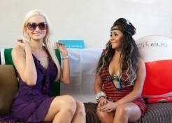 Holly Madison tries on Snooki's sunglasses at Wet Republic.