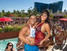 "Jionni LaValle carries Nicole ""Snooki"" Polizzi at Wet Republic."