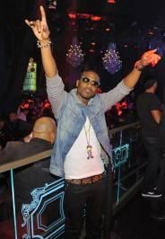 Ray J enjoys the scene from Chateau Nightclub & Gardens lavish VIP area.