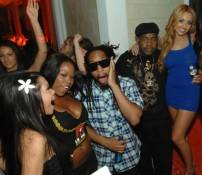 Lil Jon surrounded by lovely ladies.