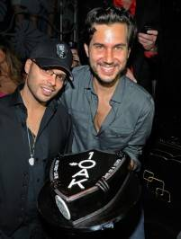 Richie Akiva, left, and Scott Sartiano show off Akiva's birthday cake with the 1OAK logo at The Bank Nightclub. The Butter Group co-founders plan to open 1OAK at the Mirage on New Year's Eve.