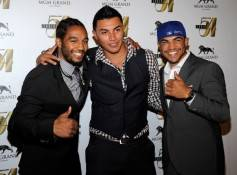From left, Victor Ortiz's sparring partner Karl Dargan, Temo Ortiz and his brother, boxer Victor Ortiz, arrive at a post-fight party at Studio 54.