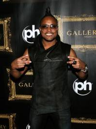 Apl.de.ap gave two peace signs as he walked the red carpet at Gallery Nightclub in Las Vegas.