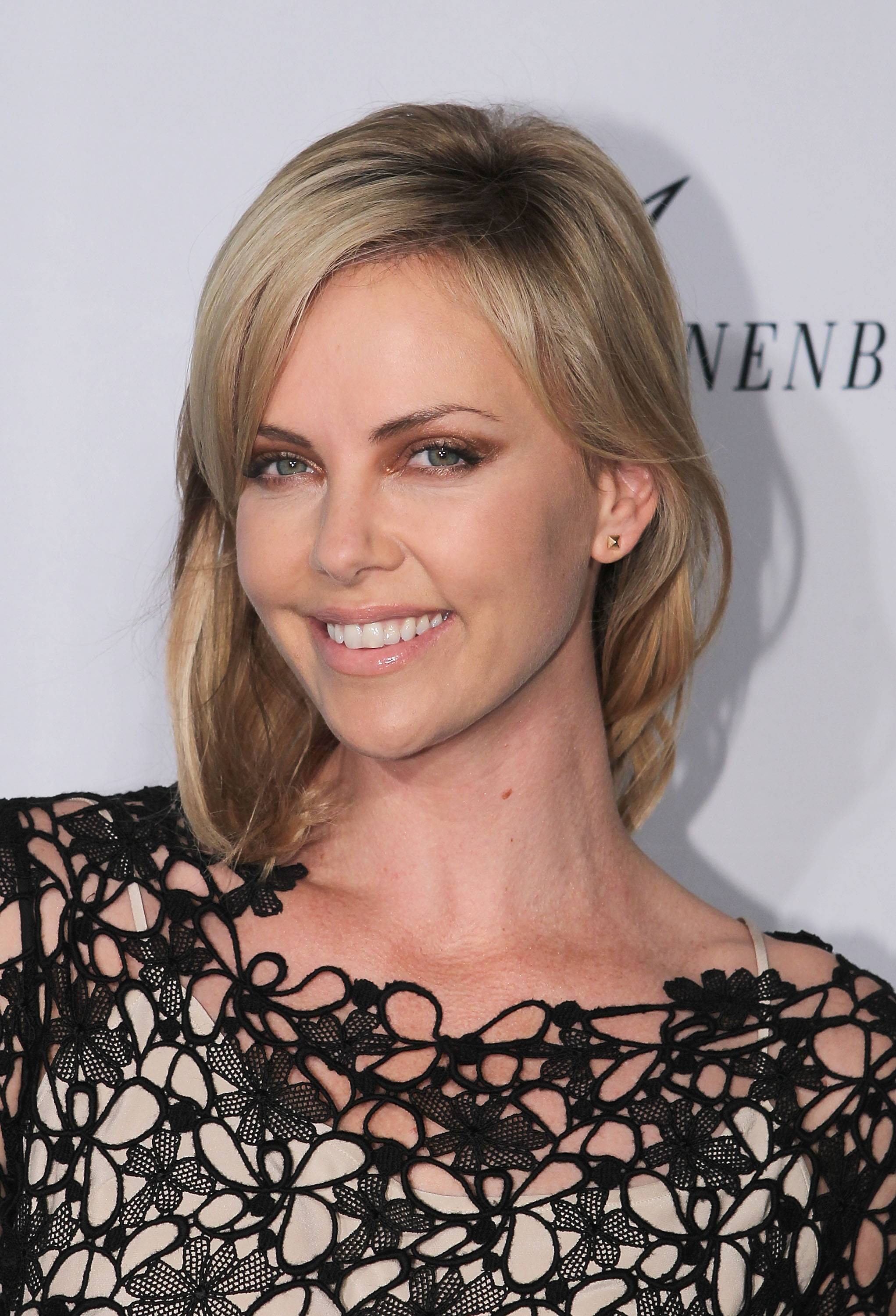 Haute Event: Charlize Theron Africa Outreach Project World Premiere of Randall Slavin Celebrity Photo Series