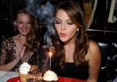 Actress Aimee Teegarden blowing out the sparkler on her birthday cupcakes at Sugar Factory American Brasserie at Paris Las Vegas.