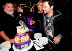 Bam Margera encourages dad Phil to take first bite of birthday cake at Studio 54.