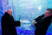 Guests of Minus5 Ice Bar help dismantle and ice replica of Kim Kardashian's 20-plus carat engagement ring ice sculpture.