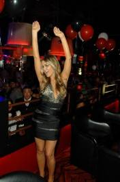 Carmen Electra dances at her VIP table.