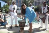 Christina Milian with drums at Azure Luxury Pool.
