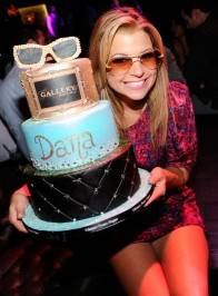 Dana Wilkey wears her infamous $25,000 sunglasses and holding her cake at Gallery Nightclub.