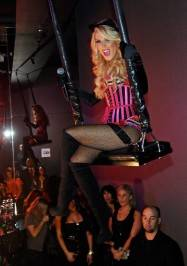 Gretchen Rossi gets a lift from the Pussycat Dolls Burlesque Saloon swing.