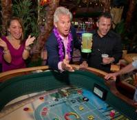 John Cohlan of Margaritaville Holdings rolls the first dice at Margaritaville Casino at the Flamingo.