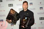 DJ Kaskade with his awards for being voted America's Best DJ.