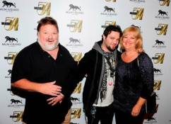 Phil, Bam and April Margera on red carpet at Studio 54.