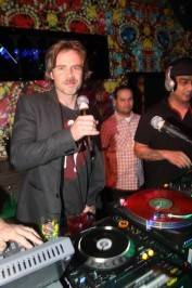 Sam Trammell in the deejay booth at Vanity Nightclub. Photo by Hew Burney