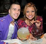 Vinny Guadagnino and Dana Wilkey with Sugar Factory goblets at Sugar Factory.