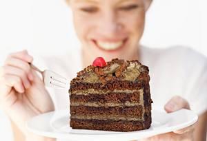 20100702-woman-eating-chocolate-cake-300x205
