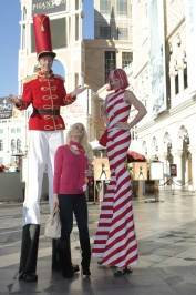 Holly Madison with the candy cane stilt walkers at the Venetian.