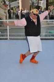 Mario Batali poses in his orange Crocs on the ice skating rink in front of the Venetian.