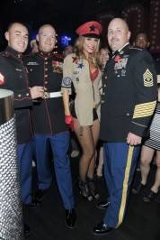 Maria Menounos poses with military men in honor of Veteran's Day weekend in Las Vegas.
