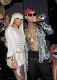 Tyga parties with his girlfriend Blac Chyna at Chateau Nightclub & Gardens.