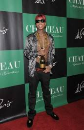 Tyga walks the red carpet at Chateau Nightclub & Gardens before his birthday celebration.
