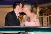 Sinead O'Conner marries Barry Herridge at A Little White Chapel drive thru in the back of a classic convertible pink Cadillac on the Las Vegas Strip. They split 16 days later.