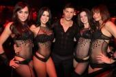 Alex Meraz with the go-go dancers at Vanity Nightclub.