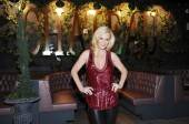 Jenny McCarthy in front of the Chateau Gardens sign at Chateau Nightclub & Gardens.