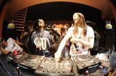 Steve Aoki and Flavor Flav behind the turntables at XS Nightclub.
