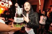 Steve Aoki with his birthday cake from Gimme Some Sugar.