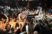 Steve Aoki does a stage dive at XS Nightclub.