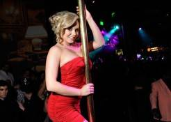 Bree Olson gets playful on the pole at Gallery Nightclub.