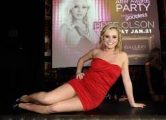 Bree Olson poses in front of her AVN after-party poster inside Gallery Nightclub.