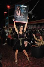 Laura Croft shows off her New Year's Eve poster at Crazy Horse III.